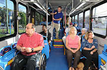 rider in wheelchair on bus